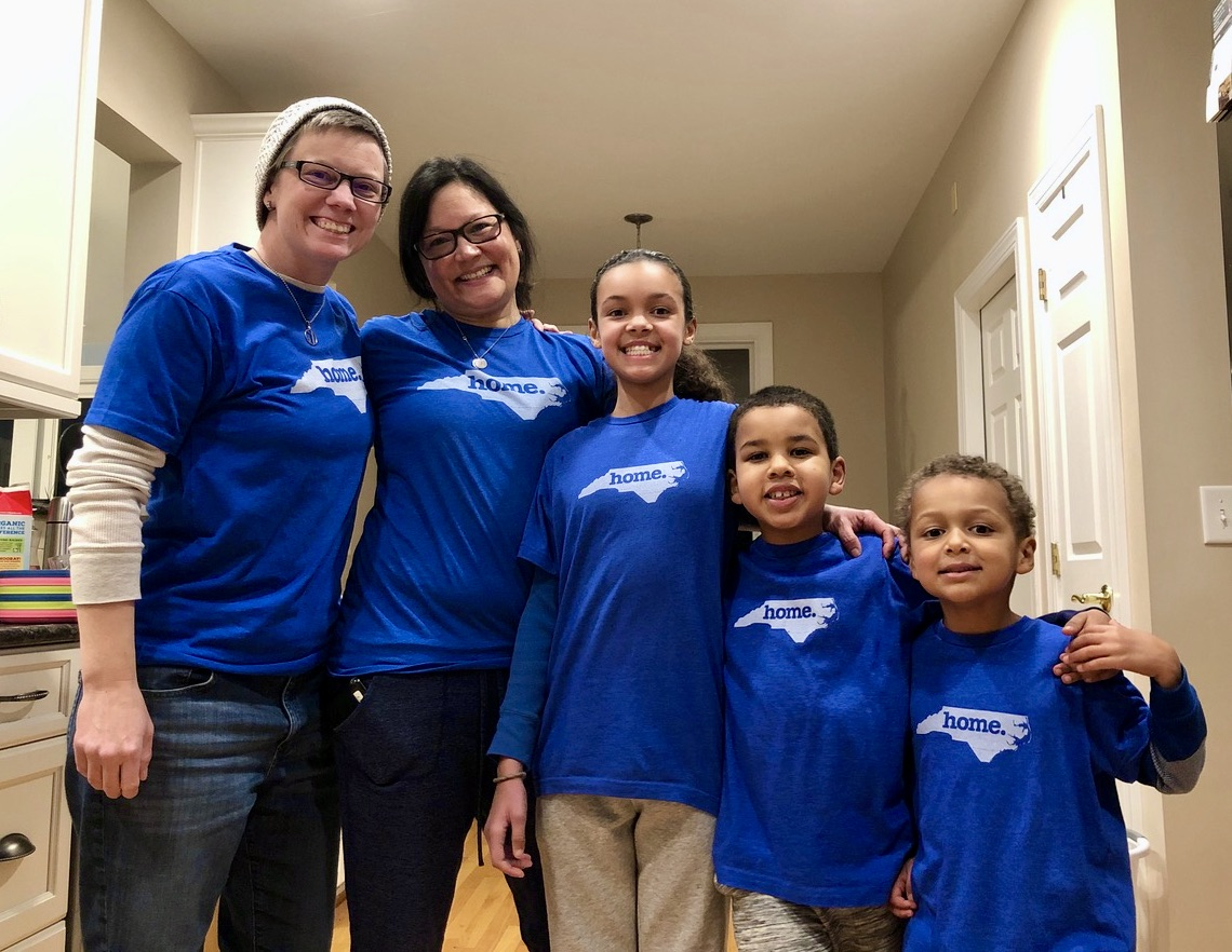 Family of five talks about how to move to another state, happily wearing new NC t-shirts