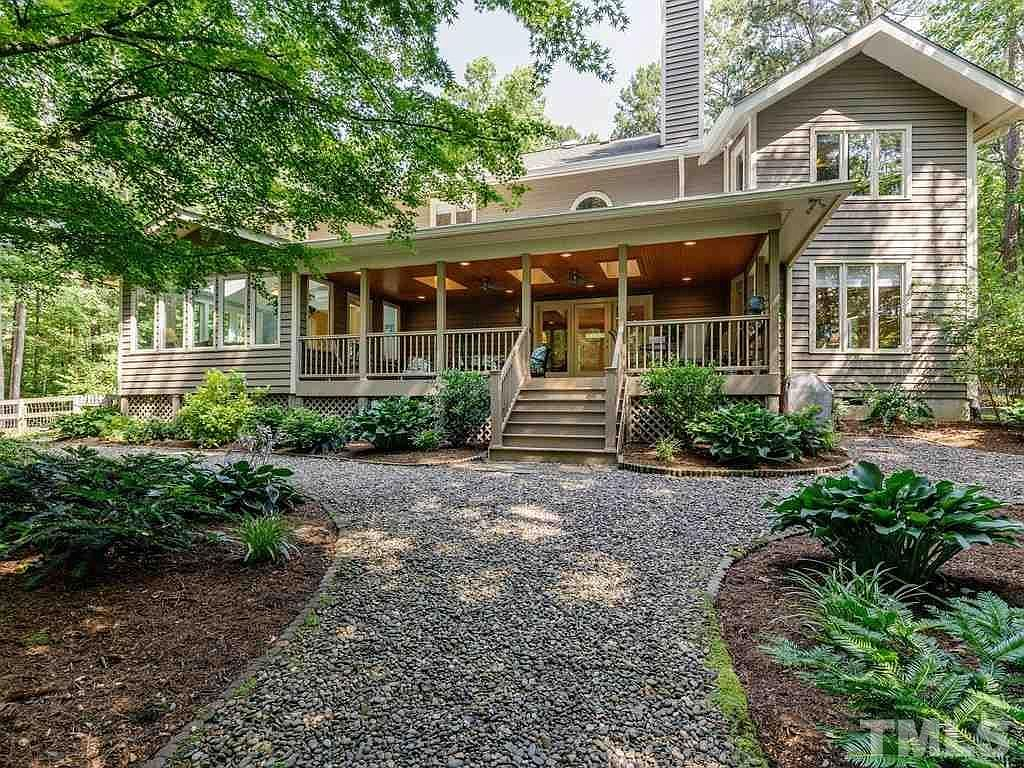 House in Chapel Hill with covered back porch and gravel paths and landscaping
