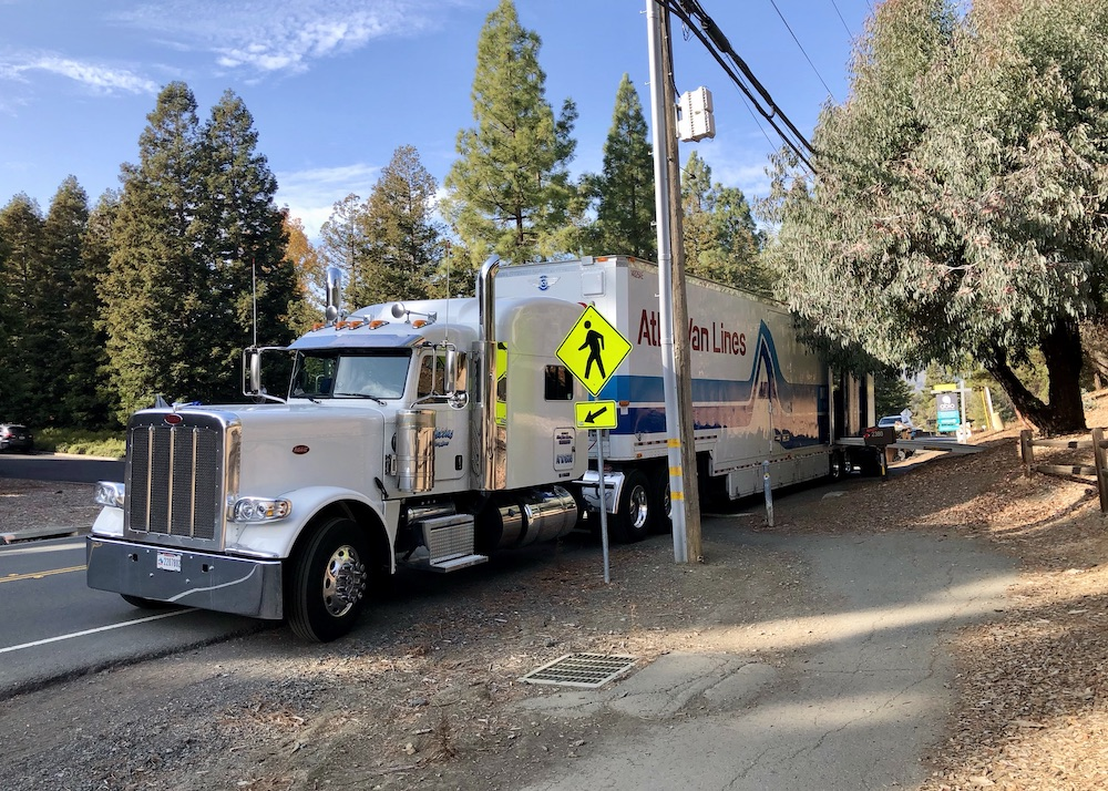 "Moving truck outside a home for sale in Martinez, CA, with Abio Properties ""for sale"" sign in background"