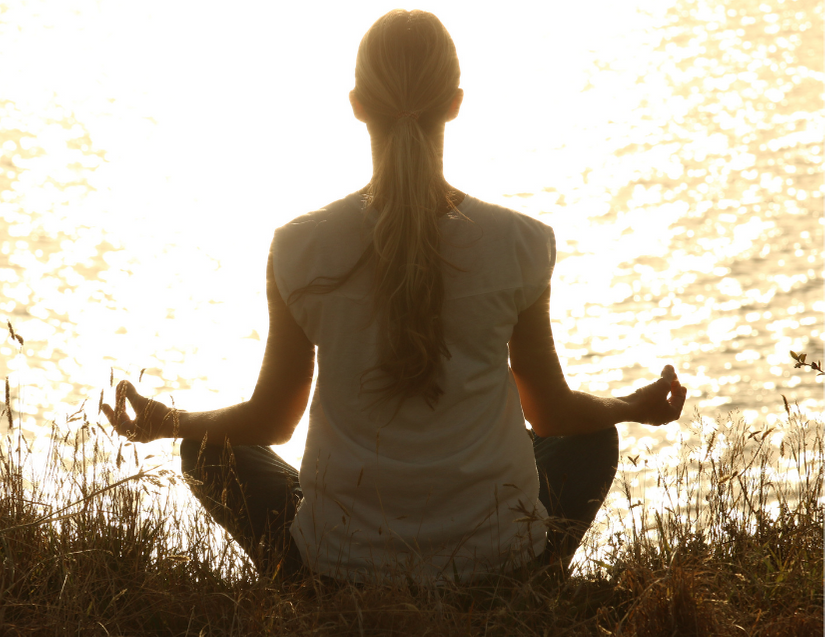 Woman meditating, demonstrating patience homebuyers need in the real estate market